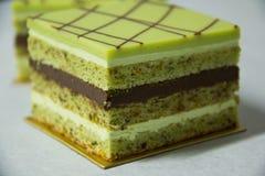 Pistacho layer cake and chocolate garnache Stock Photos