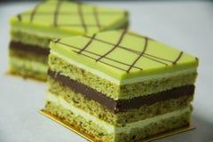 Pistacho layer cake and chocolate garnache Royalty Free Stock Image