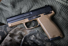 Pistal automatic short hand gun. Pistal automatic short hand gun in the  US army prop background photo in lowlighting and dark shadow concept Stock Photos
