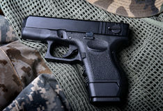 Pistal automatic short hand gun. Pistal automatic short hand gun in the  US army prop background photo in lowlighting and dark shadow concept Royalty Free Stock Photos