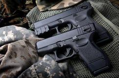 Pistal automatic short hand gun. Stock Photos