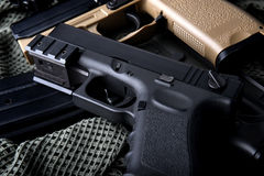 Pistal automatic short hand gun 9 mm. Pistal automatic short hand gun in the  US army prop background photo in lowlighting and dark shadow concept Stock Image