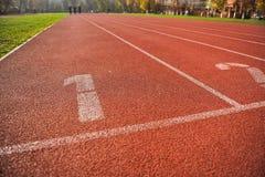 Pistas da trilha do atletismo Imagens de Stock