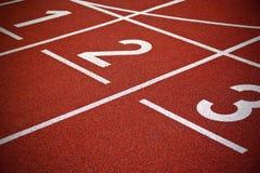Pistas da trilha do começo do atletismo Fotografia de Stock Royalty Free