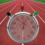 Pistas de atletismo com cronômetro Fotos de Stock Royalty Free