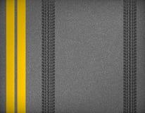 Pistas del neumático en el camino Imágenes de archivo libres de regalías