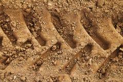 Pistas del neumático en fango Imagen de archivo