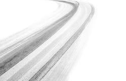 Pistas del neumático en nieve Imagenes de archivo