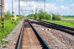 Pistas ferroviarias con el interruptor del ferrocarril Foto de archivo libre de regalías