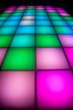 Piste de danse de disco avec l'éclairage coloré Images libres de droits