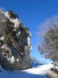 Piste de montagne dans la neige Photographie stock libre de droits