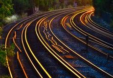 Piste del treno al tramonto Fotografie Stock
