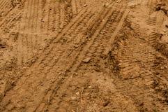 Piste della gomma del camion in fango Fotografia Stock