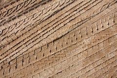 Piste della gomma nella sabbia Fotografia Stock Libera da Diritti