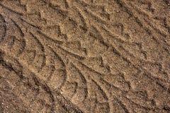 Piste della gomma in sabbia Immagini Stock Libere da Diritti