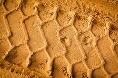 Piste della gomma sulla sabbia Immagine Stock Libera da Diritti