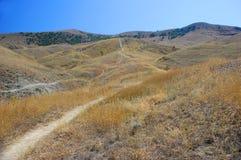 Piste en montagnes Photographie stock libre de droits