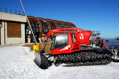 The Pisten Bully 600 groomer for ski slopes preparation. MADONNA DI CAMPIGLIO, ITALY - DECEMBER 14: The Pisten Bully 600 groomer for ski slopes preparation on royalty free stock image