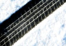 Pistes dans la neige Photographie stock libre de droits