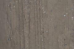 Pistes de pneu dans le sable Image libre de droits