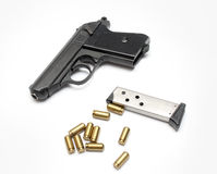 Pistol. On a photo  pistol with ammunition on a white background Royalty Free Stock Photos