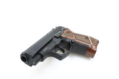 Pistol. The close up of a pistol a target and cartridges is isolated on a white background Stock Image