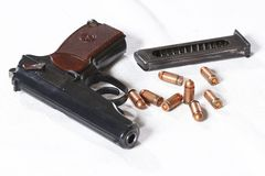Pistol. Close up view of pistol and magazine and shell Stock Image