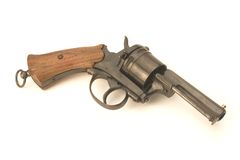 Pistol. Old pistol at the white background Stock Image
