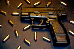 Pistol and 9mm P+ Rounds. Ammunition and Gun locked and loaded for use stock photos