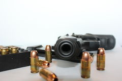 Pistol and ammo. Pistol barrel with clip and ammunition on white background Stock Images