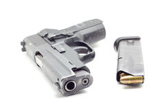 Pistol with ammo ,white background Stock Photos