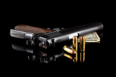 Pistol 1911 with ammunition on black Royalty Free Stock Images