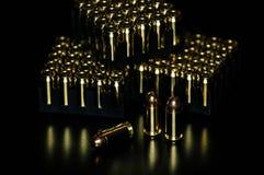 Pistol ammunition with the dark background. 45ACP caliber Stock Photos