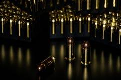 Pistol ammunition with the dark background. 45ACP caliber Royalty Free Stock Photo