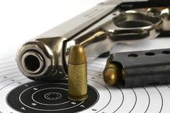 Pistol and ammunition. On the white background Royalty Free Stock Photos