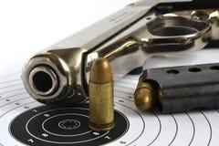 Pistol and ammunition. On the white background Stock Image