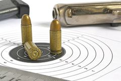 Pistol and ammunition. On the white background Royalty Free Stock Images