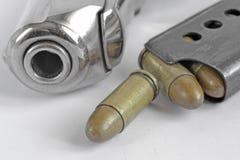 Pistol and ammunition Stock Photography