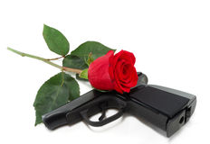 Pistol And A Red Rose Stock Photography