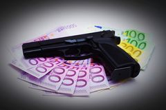 Pistol And Banknotes Royalty Free Stock Images