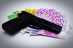 Pistol And Banknotes Stock Photography
