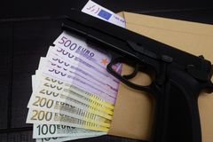Pistol and banknotes Royalty Free Stock Photography
