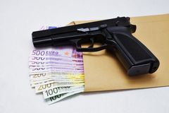 Pistol and banknotes Stock Image