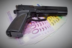 Pistol and banknotes Stock Photo