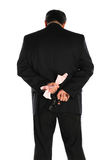 Pistol behind the suit Stock Images