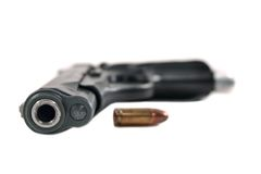 Pistol (black). Black pistol with one bullet isolated on white Royalty Free Stock Photography