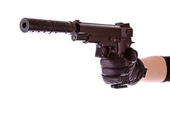 Pistol on black glove isolated Royalty Free Stock Image