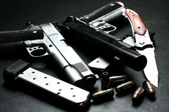 Pistol and blade Stock Images