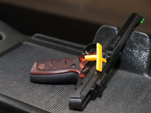 Pistol with breach safety flag Stock Photos