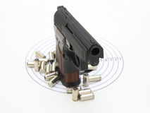 The pistol with the brown handle Stock Image